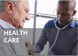 Doctor examining senior patient with stethoscope.
