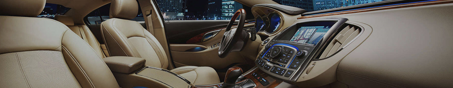 Interior of a luxury car at night in a city.